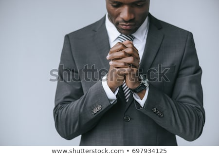 Businessman praying Stock photo © RTimages