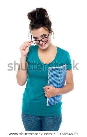 Pretty girl taking off her glasses to watch you closely Stock photo © stockyimages