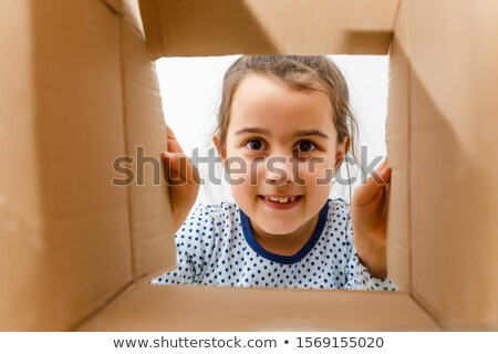 Face and cardboard boxes Stock photo © pzaxe