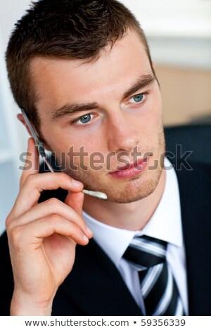 Tolakodó üzletember beszél headset fehér üzlet Stock fotó © wavebreak_media