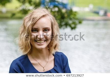 Fiatalos szőke lány izolált fehér boldog Stock fotó © acidgrey