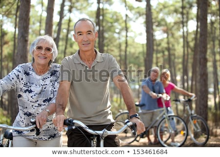 four senior people doing bike in a pine forest stock photo © photography33