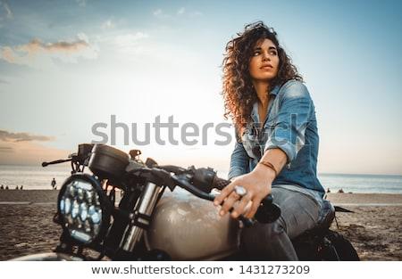 Motoros lány motorkerékpár bőrdzseki néz naplemente Stock fotó © cookelma