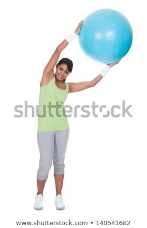 Vonzó fiatal nő tart egyensúlyozó labda portré aranyos Stock fotó © williv