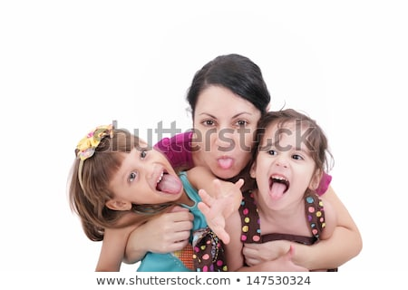 mother and two daughter pulling funny faces at camera stock photo © dacasdo