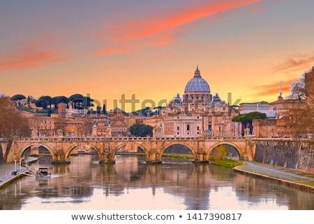 Sunset view of St. Peter and Tiber river Stock photo © SecretSilent