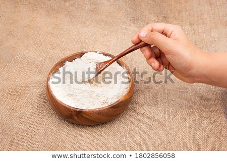 Burlap fabric with wooden spoon. Stock photo © asturianu