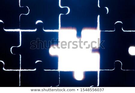 wooden puzzle and backlight background close up stock photo © deyangeorgiev