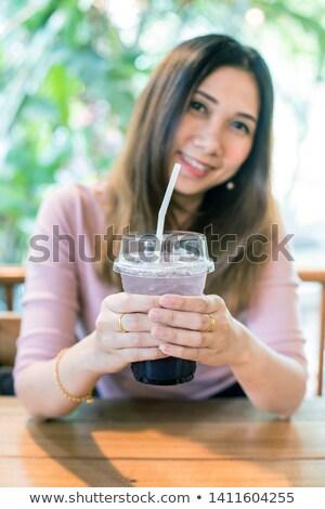 beautiful blond girl drinks grape juice in a restaurant stock photo © nejron