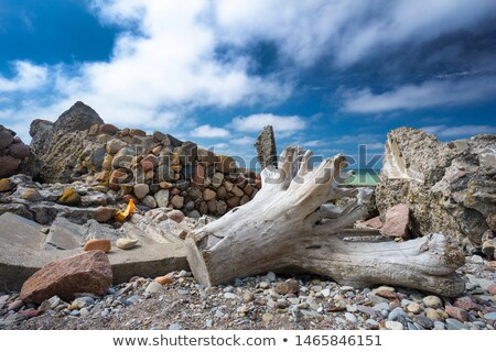 Landscape format wide angle pebble beach and blue sky Stock photo © jenbray