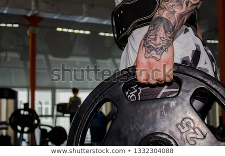 Izmos fiatal sportoló súlyemelés öv sport Stock fotó © Nejron