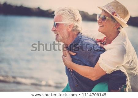 boldog · pár · szórakozás · tengerpart · fiatal · új - stock fotó © monkey_business