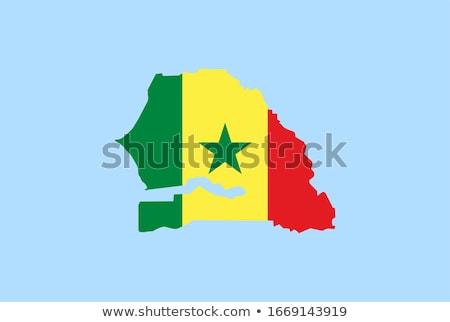 Senegal Flag on a Map Background. Stock photo © tashatuvango