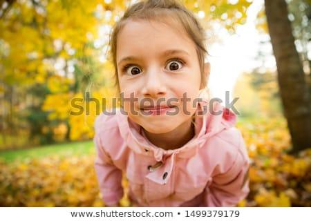 kislány · készít · vicces · arc · izolált · fehér · lány - stock fotó © nejron