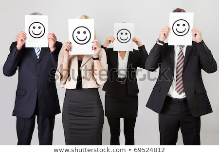 Businessman showing smiley face Stock photo © bmonteny