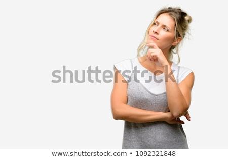 Belo mulher jovem intrigado em pé câmera mãos Foto stock © dash