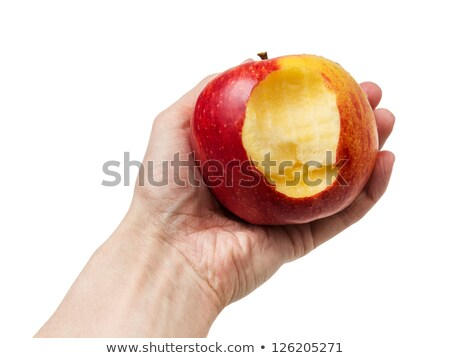 bitten red apple in mans hand isolated on white stock photo © entazist