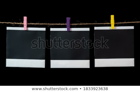 rows of colorful paper clips on black card stock photo © latent