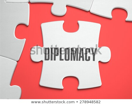 Diplomacy - Puzzle on the Place of Missing Pieces. Stock photo © tashatuvango
