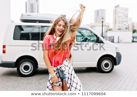 Young blonde girl dancing on the road Stock photo © dariazu