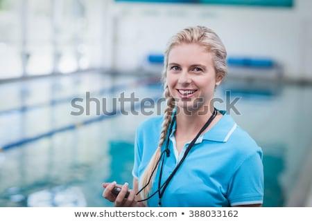 Nuoto istruttore cronometro piscina tempo libero Foto d'archivio © wavebreak_media