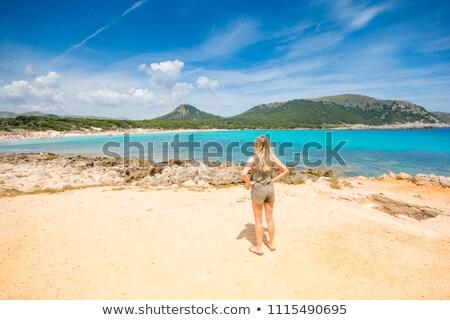 Blond tourist girl in Cala Agulla beach of Mallorca Stock photo © lunamarina