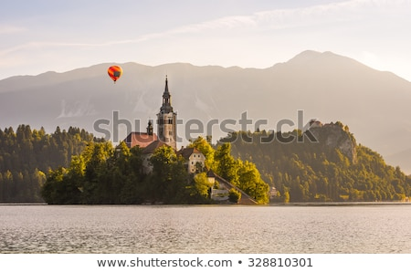 Detail of Catholic Church in Bled Lake, Slovenia with Hot Air Ba stock photo © Kayco