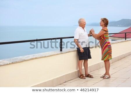 Smiling elderly married couple on veranda near seacoast, play ha Stock photo © Paha_L