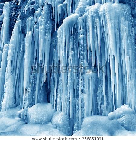 Frozen waterfall of blue icicles Stock photo © vapi