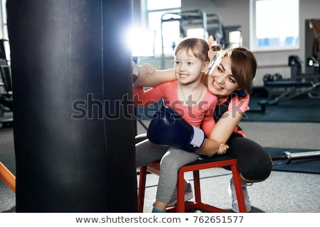Mom teaches daughter punch kicking karate Stock photo © Andreyfire