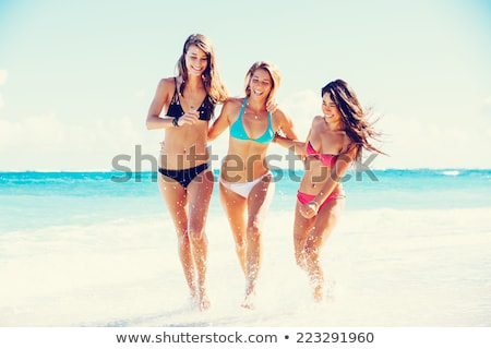 радостный девушки пляж счастливым Постоянный воды Сток-фото © Anna_Om