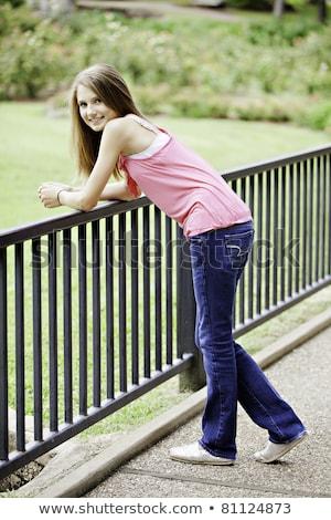 Beautiful Woman Leaning On Fence Outside Stock fotó © mkm3