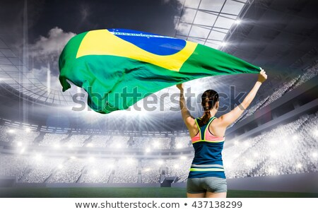 Composite image of rear view of sportswoman raising a brazilian  Stock photo © wavebreak_media