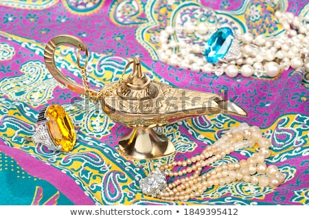 Genie in pink costume and golden lamp Stock photo © bluering