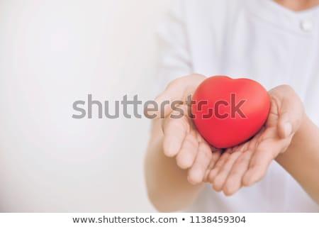 boldog · terhes · nő · piros · szív · alakú · vánkos - stock fotó © nobilior