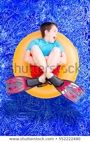 Loud noisy little boy playing in a swimming pool Stock photo © ozgur