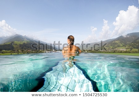 Young girl spending a relaxing day in the pool Stock photo © ozgur