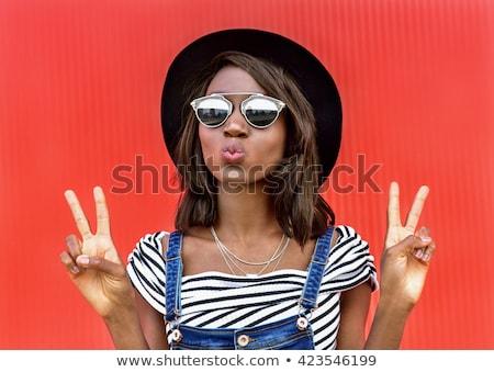 young pretty african american girl teenage outside on street, lo Stock photo © iordani
