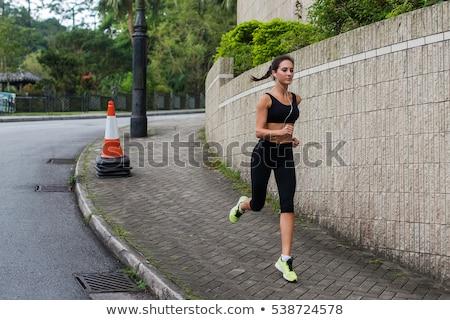 きれいな女性 · ジョギング · 舗装 · 側面図 · スポーティー · 女性 - ストックフォト © dash