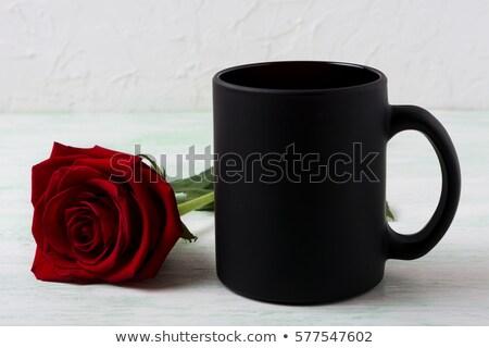 black coffee mug mockup with red rose stock photo © tasipas