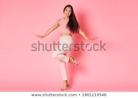 Młodych dość asian kobieta stwarzające wesoły Zdjęcia stock © iordani