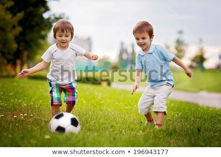 nino · futbolista · jugando · fútbol · eps10 · vector - foto stock © bluering