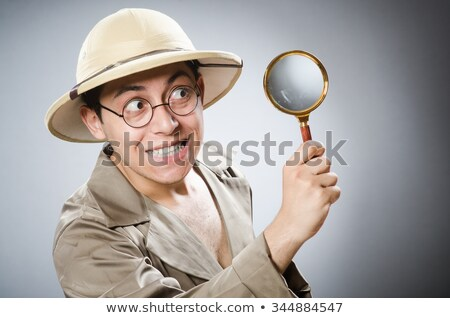 Woman with magnifying glass in sports concept Stock photo © Elnur