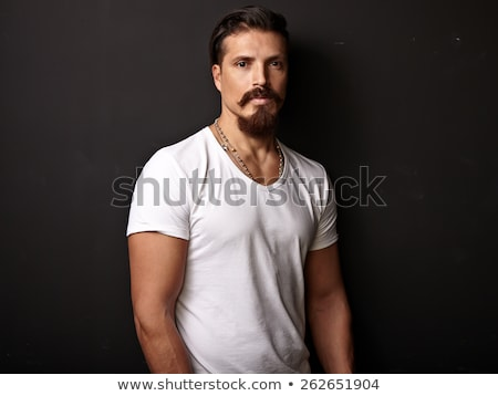 Portrait of brutal bearded man wearing blank t-shirt Stock photo © andreonegin