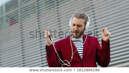 Businessman with music player Stock photo © gravityimaging