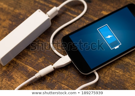 mobile phone charging with power bank stock photo © adamr