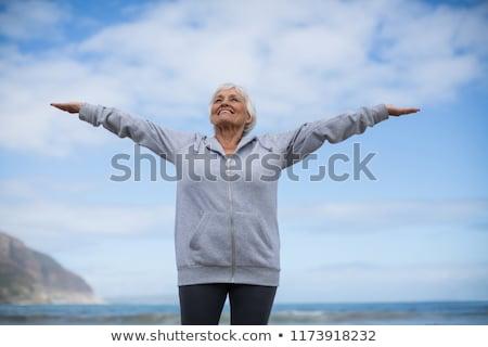 счастливым старший женщину оружия Постоянный берега Сток-фото © wavebreak_media