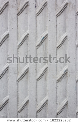 The texture of the paint is white. Wall background with plaster and stains. A screensaver or a postc stock photo © ivo_13