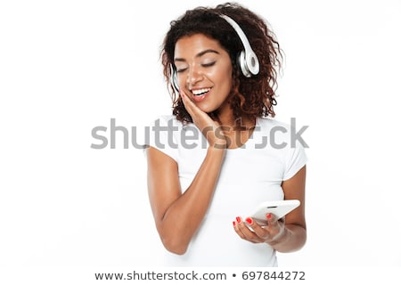 happy young african lady standing isolated stock photo © deandrobot