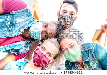Stock photo: multiethnic friends taking selfie
